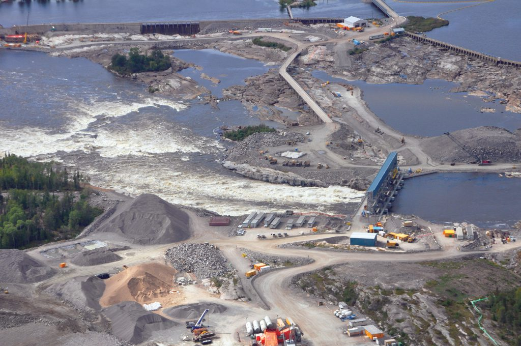 A 5,000-foot view of the Winnipeg River meeting Pointe du Bois Spillways with all 7 gates in action, which replaced 97 existing gates.