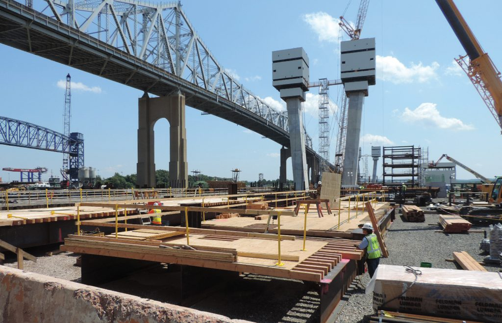 The new Goethals Bridge begins to come into view next to the nearly 90-year-old original structure.