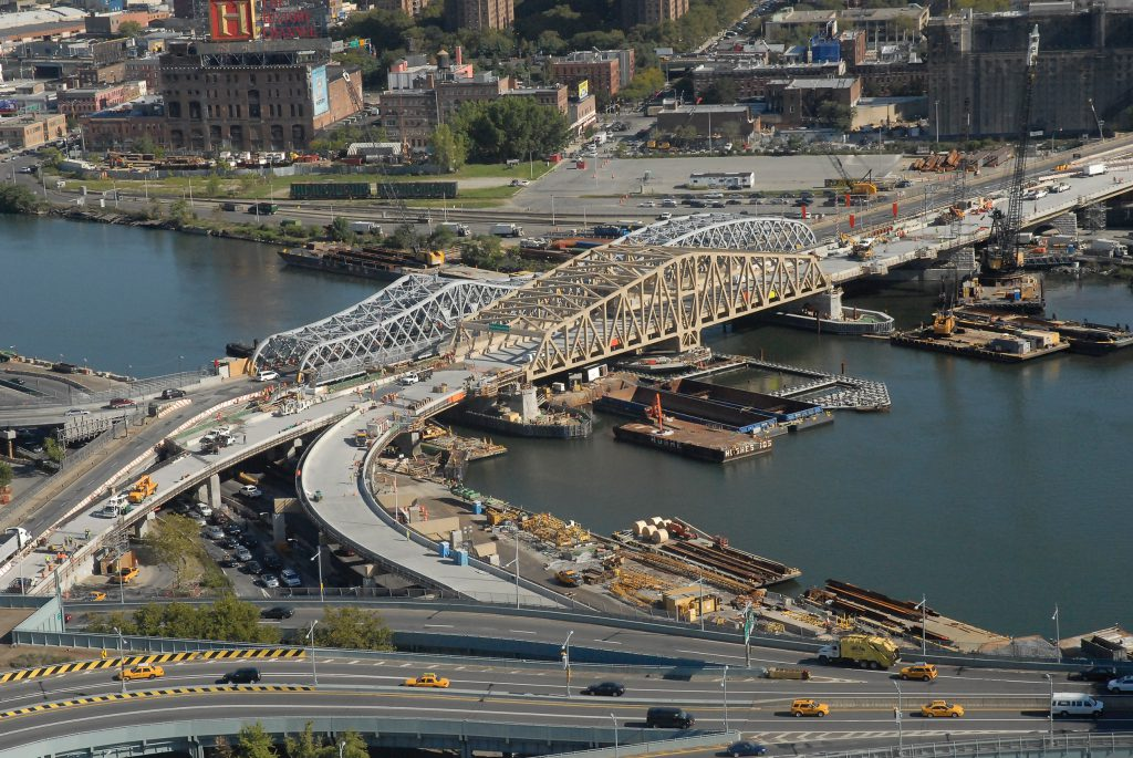 The Willis Avenue Swing Bridge connects Manhattan and the Bronx over the Harlem River and swings open to accommodate marine vessels.