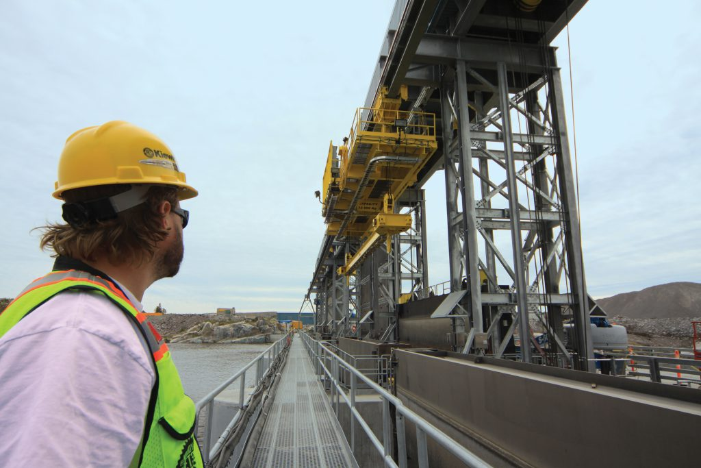 Lost in the moment – a Kiewit employee gazes on the successful commissioning of the stop log monorail crane.
