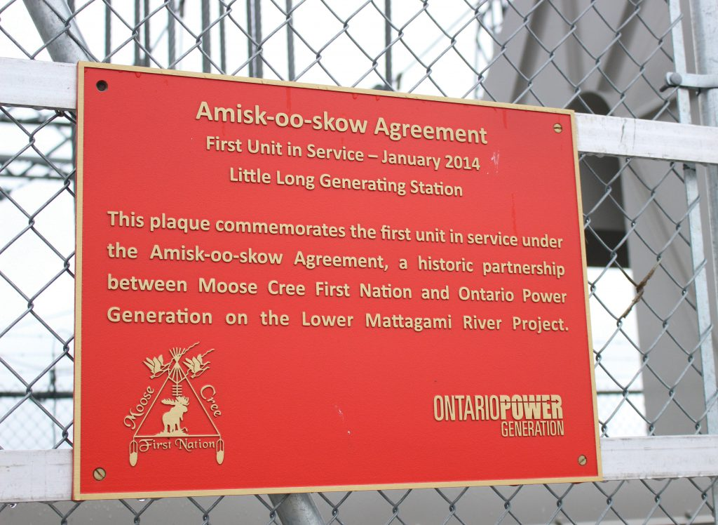 A plaque commemorating the first unit in service at the Little Long Generating Station reminds us of the importance of the Amisk-oo-skow Agreement to Kiewit's relationships with the Moose Cree and OPG.