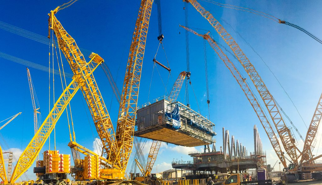 A multi-crane module lift takes place at the Kiewit Offshore Services yard in Ingleside, Texas.