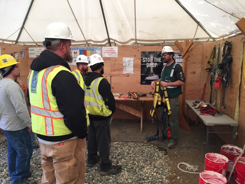 CVIS Liaison Dave Mefford reviews fall protection with new hires in the CVIS Education Center at the Replacement Medical Center Facility in Colorado.
