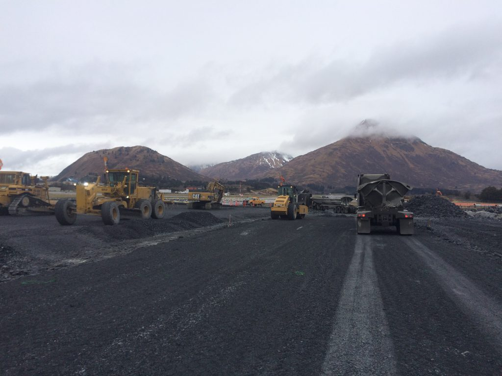 Subbase materials are placed at the end of Kodiak Airport's runway 25.