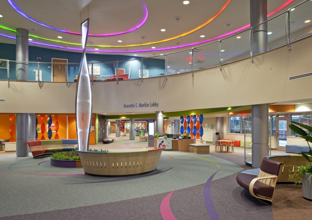 Vibrant colors and an open floor plan to provide a welcoming atmosphere for patients and families at the Children's Hospital Specialty Pediatric Center.