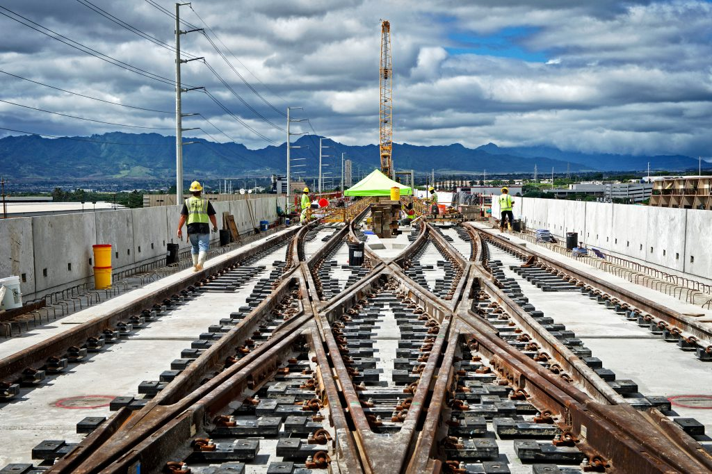 Kiewit laid 224,000 linear feet of rail and built various crossovers along the alignment, including at the future Pearlridge station.