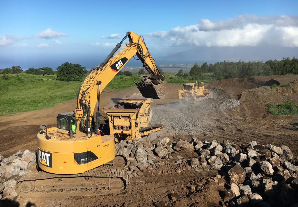 A crushing operation takes place in Hawaii using Kiewit-owned equipment.