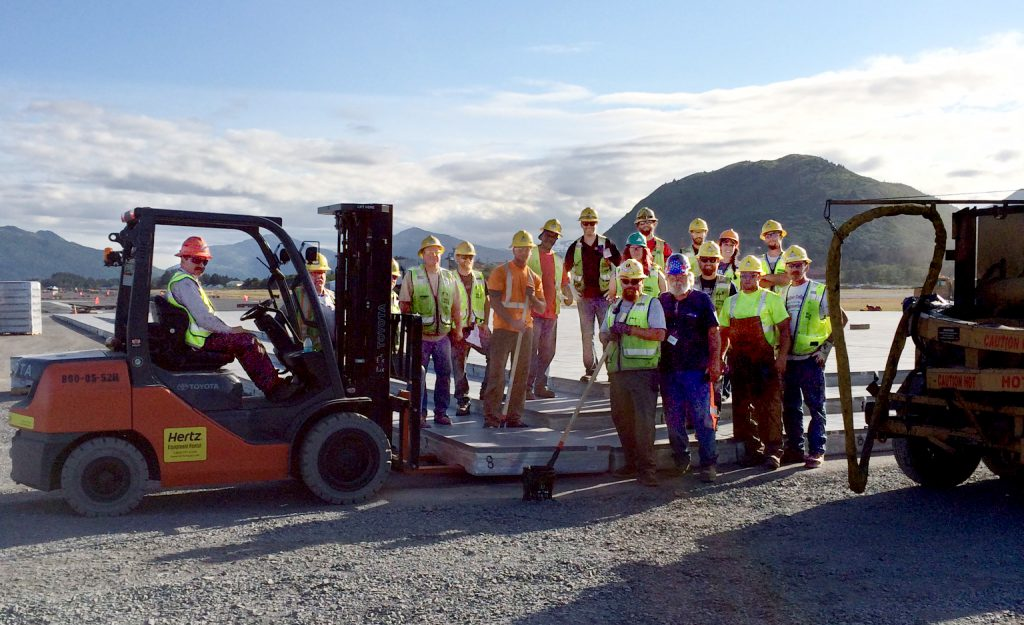 Workers install the last EMAS block at Kodiak Airport.