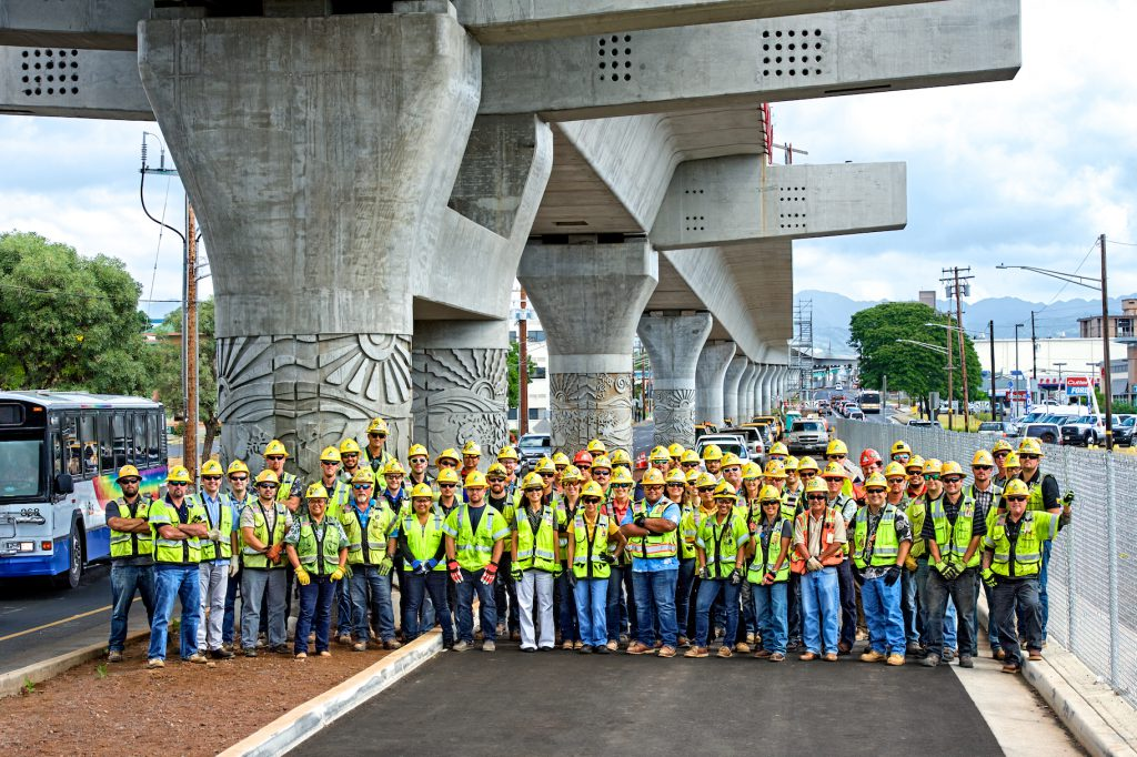Kiewit staff pose for a picture near the West Loch station work site on Farrington Highway.