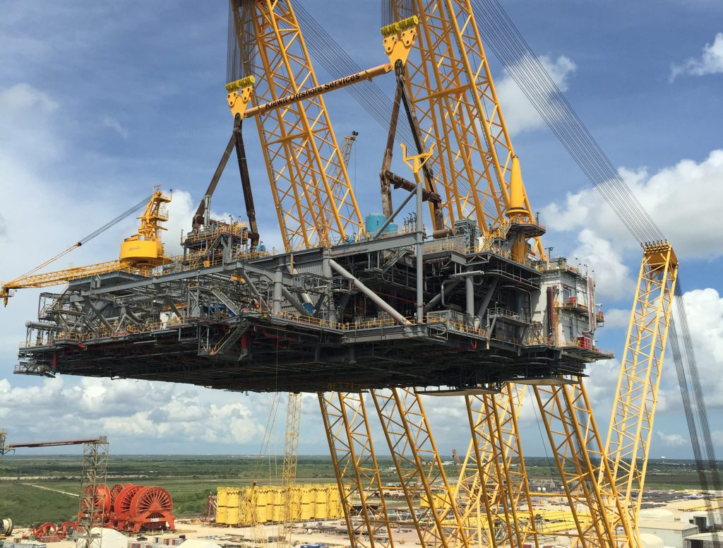 The heavy lifting device (HLD) lifts an offshore topsides platform. The HLD is the only one of its kind and can lift 13,000 tons at a radius of 225 feet.