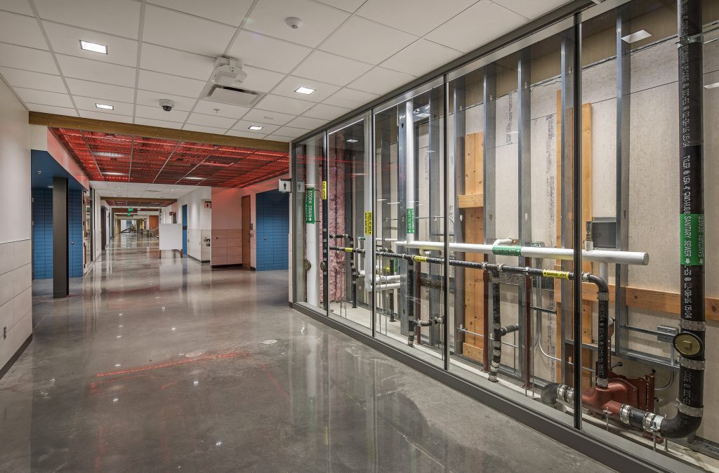 In the new Construction Education Center (CEC) even the building is a teaching tool. Plumbing, utilities, electrical and mechanical systems are all visible through interior glass and lighting.