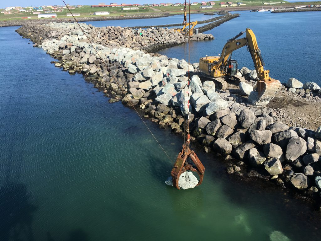 More than 32,000 cubic yards of armor stone and scour rock were placed on the breakwater repairs.